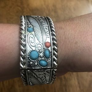 Gorgeous pieces of art on a brazalete.